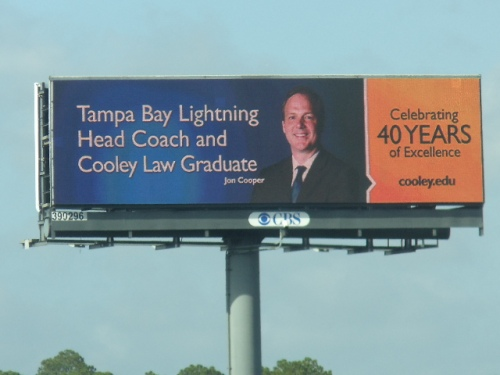 Jon Cooper billboard in downtown Tampa during Cooley's 40th Anniversary celebration.
