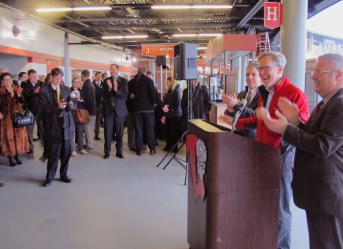 Lansing Lugnuts Chief Executive Officer Tom DIckson celebrates the Grand Re-Opening of Cooley Law School Stadium at a Ribbon-Cutting on opening day.
