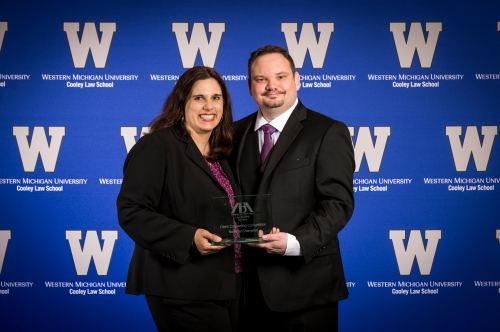 Elizabeth and Bryan Devolder holding their national award for the ABA Client Competition