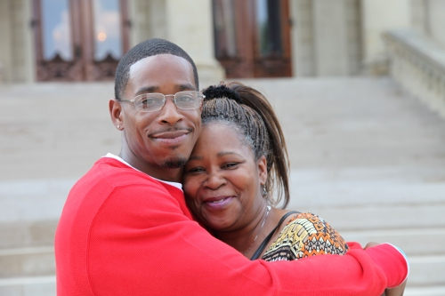 Donya Davis gives his mom, Denise Larry, a big hug on the Capitol steps after a news conference on May 7, 2015, introducing Senator Steve Bieda's bill to provide compensation to the wrongfully convicted.