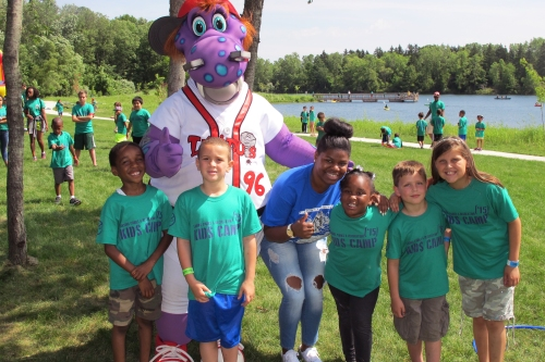 "WMU-Cooley law student Denaye Wallace and Parks & Rec kids enjoying Cooley for Kids ""Day with Big Lug"" at Crego Park on June 17."