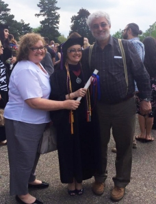 DJ Remole and her parents on Graduation Day.