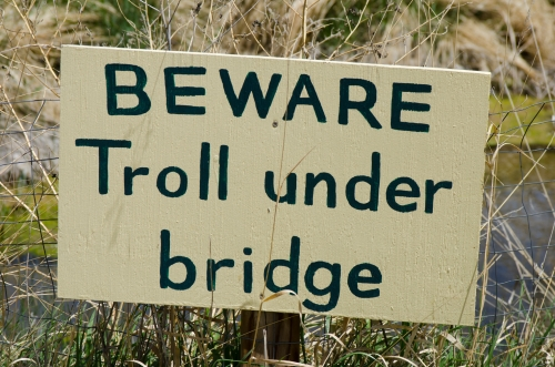 A hand painted sign informing visitors that a troll lives under the bridge is pretty entertaining!