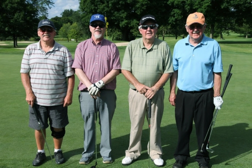 WMU-Cooley Law School President Don LeDuc (far right) teams up with his brothers, (from left) Reed, Kevin, and Dan, for the 26th Annual Alumni Memorial Scholarship Golf Outing.