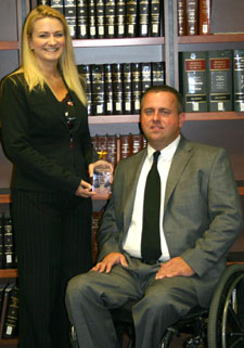 Shane Goodale received WMU-Cooley's Student Great Deeds Award from Heather Spielmaker in 2011.