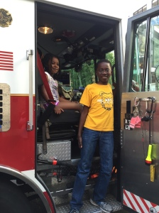 Kids take the driver's seat at WMU-Cooley Law School's Children's Law Society Summer Safety event on July 13, 2015.