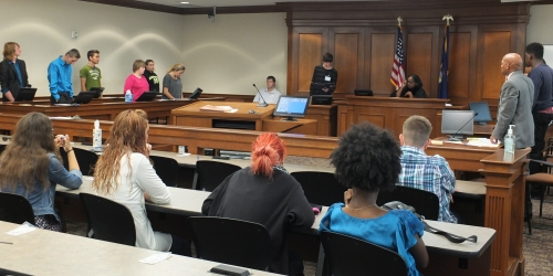 Teen Court Honorary Judge Professor Mable Martin-Scott guides Teen Court participants through the hearing process at Western Michigan University Cooley Law School.