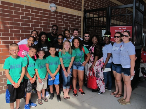 WMU-Cooley law students and Parks & Rec kids at Cooley Law School Stadium.
