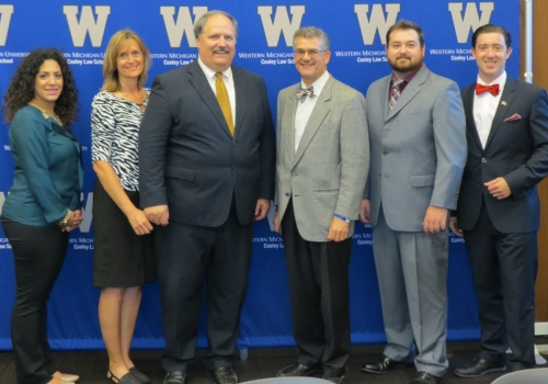 From left, Federalists Society Co-President Krystal Yalldo, Assistant Dean Lisa Halushka, Professor Ronald Rychiak, the Hon. Michael Warren, Federalist Society Co-President Joseph Falzon, and SBA President Michael Ruso.