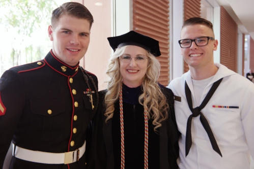 Debra on Graduation Day, with her God son, Mike Jones (left), and son Michael.