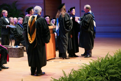 Matt Marin receives his doctoral hood for his LL.M. degree in IP law by Dean Jeff Martlew and Professor Kathy Gustafson during the graduation ceremony on Aug. 15, 2015.