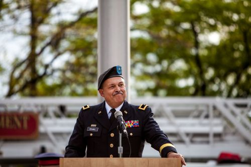 Retired Brigadier General and current Western Michigan University Cooley Law School Professor Michael C.H. McDaniel speaks during commemoration ceremonies for Grand Rapids' Day of Remembrance and Scout Salute at the Gerald R. Ford Presidential Museum.