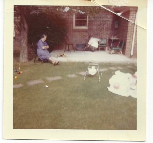 My only picture of Nana. Here she is relaxing in the backyard, while my father is in the background working on something, and me off on the side in the stroller.