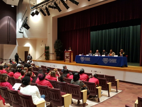 High school students listen attentively to a panel of law enforcement official, judges, and WMU-Cooley law experts on how to respond to a legal encounter event Nov. 9.