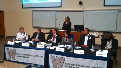 Panel speakers from WMU-Cooley Law Review Symposium discuss their opinions on the use of equipment by police. From left to right, Michelle LaJoye-Young, Gerry Faber, Brian Lennon, Kara Dansky, Joseph Jones, Darel Ross, and moderator Tonya Krause-Phelan.