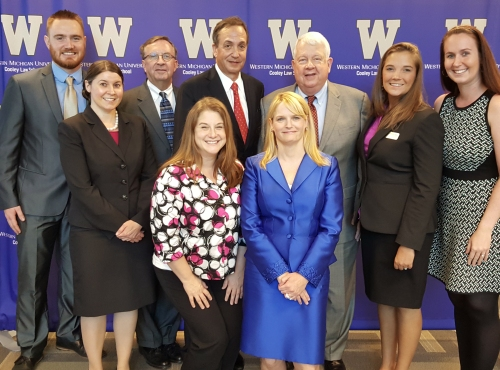Winning Edge Panel with WMU-Cooley students: Front row (left and right) WMU-Cooley student Governor Kimberly Canals and Attorney Caroline Johnson Levine. Back row (left to right) WMU-Cooley student Governor Brandon Porter, WMU-Cooley Professionalism Director Amy Bandow, Judge Edward LaRose, Attorney Henry Paul, Attorney Michael Colgan, Student Governor Lisa Centrangolo, and student Governor Cynthia Whitman