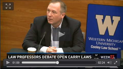 WMU-Cooley Adjunct Professor Steven Dulan, with a military background, talks during a debate over the right to legally carry guns in Michigan schools.