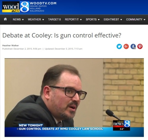 WMU-Cooley Professor David Tarrien, with a background in education, speaks to audience during debate over gun control.