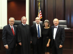 From left: State Bar of Michigan President-Elect Larry Nolan, Justice Stephen J. Markman, newly admitted Martin Fisher, and Martin's parents, Julie and Professor Gerald Fisher.