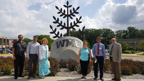 The first class of WMU-Cooley law students on WMU's campus in Kalamazoo during orientation — (L to R) students Dustin Blaszczyk, Lee Melde, Christine Doxey, Marla LaMae, and Kenneth Estephan, and WMU-Cooley Enrollment & Clinical Coordinator Bill Fleener.