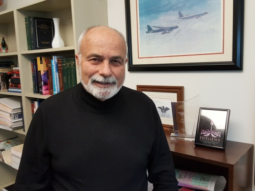 Professor Gary Bauer was a Captain in the U.S. Air Force and Navigator-Bombardier. He proudly displays a photo in his office of the B-52 and KC 135 aircraft he flew during service.