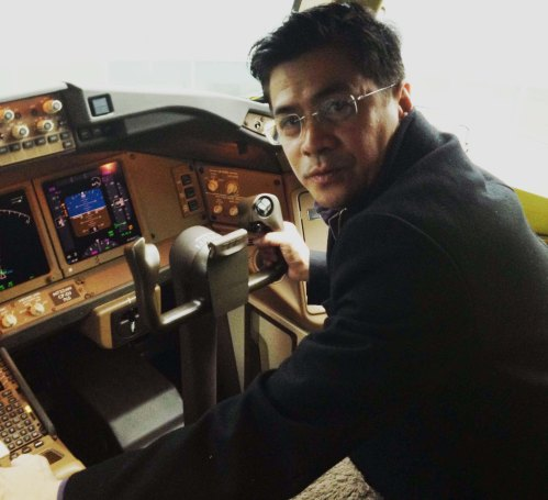 A recent graduate of WMU-Cooley Law School who commuted to weekend classes from Seattle from Seattle, Mel Matias is a CPA and auditor with Boeing and is pictured in the cockpit of a Boeing 787 for delivery. Photo courtesy of Mel Matias.