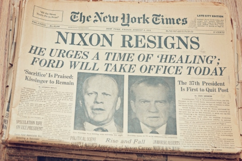 """New York, New York, USA - November 3, 2012: A close up of the front page of the The New York Times newspaper dated August 9, 1974. The New York Times reporting President Richard Nixon resigns after the Watergate scandal, Vice President Gerald Ford taking office."""