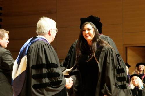 WMU-Cooley President and Dean Don LeDuc presents Erika Martinez with her diploma during WMU-Cooley Law School's spring commencement.