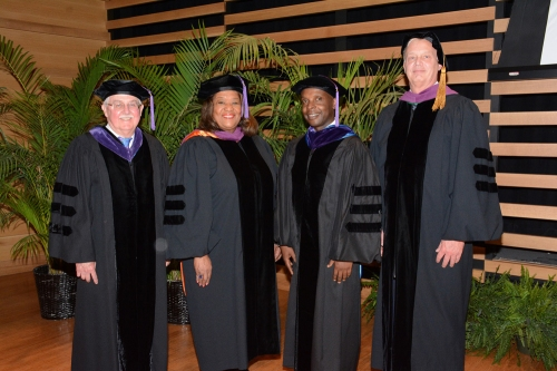 Left-right: Don LeDuc, WMU-Cooley president and dean; Hon. Barbara Twine Thomas, Hillsborough County 13th Judicial Circuit; Ricardeau Lucceus, graduate and valedictory presenter; and Ronald Sutton WMU-Cooley associate dean.