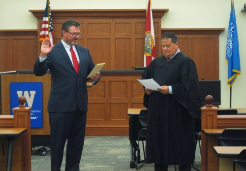 Judge swears in new lawyer