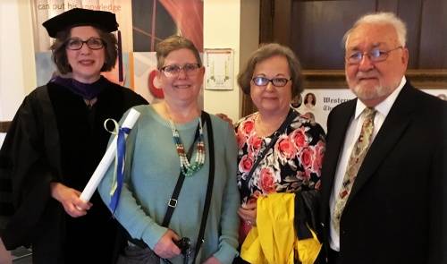 Julie Lawler-Hoyle was honored with the Distinguished Student Award at WMU-Cooley Law School's May graduation. She is pictured with her wife, Sally, and in-laws Jim and Connie Hoyle.