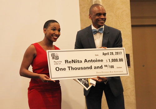 Davis-Dunnings Bar Association President and WMU-Cooley graduate Takura Nyamfukudza presents WMU-Cooley student ReNita Antoine with Scholarship Award