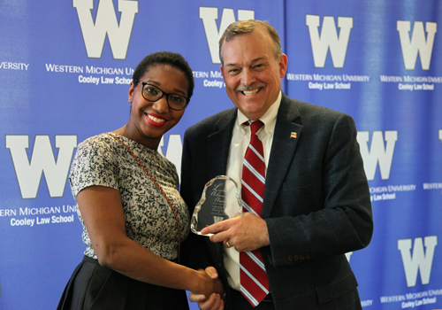 Associate Dean Michael McDaniel presents WMU-Cooley student ReNita Antoine with Leadership Award