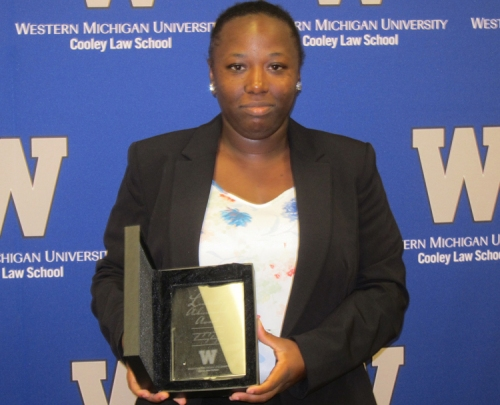 Selena Neal with award