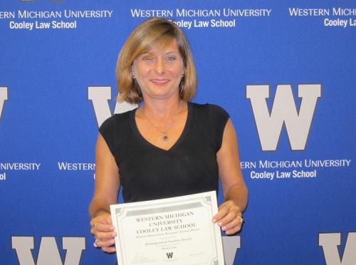 Sheila Lake with award